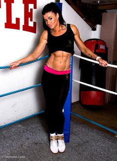 Model wears Pink waist embroidered exercise leggings with Black and Gold S.H work out vest.