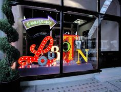 Christian Louboutin Window by Studio XAG. Love the different sizes of letters for contrast and movement