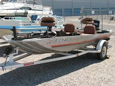 Bass tracker and a merc' 85hp. Many weekends skiing behind this. Best boat ever. Tough as nails.