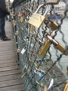 This is a bridge in Paris, what you do is right your bf/gf on the padlock then throw the key into the river behind so even when the relationship ends the lock with your past love's name is there forever. Cute.