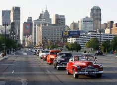 A parade of classic and iconic vehicles heads up Woodward Avenue in Detroit, Michigan during the annual Woodward Dream Cruise.