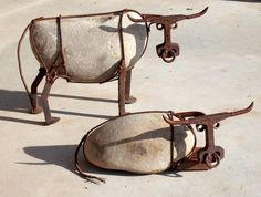 by WilhelmsArt (Cattle made from river rock, railroad spikes, railroad track, steel wire, and nuts)