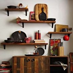 Reclaimed Lumber Shelves The most obvious use for salvaged wood? Display your photos and books atop a warm, natural-edged plank of wood that fits with whatever bracket you like. Reclaimed Wood Shelves, Reclaimed Lumber, Salvaged Wood, Wood Shelf, Wall Shelves, Diy Shelving, Bedroom Shelves, Rustic Shelves, Rustic Wood