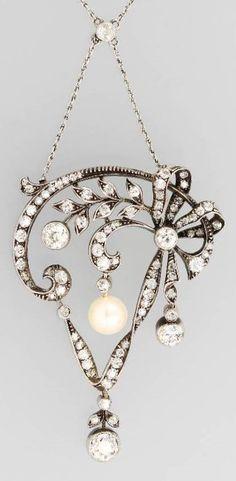 An Art Nouveau-inspired vintage silver, platinum, diamond and pearl pendant, about 1925. Dimensions: 5 x 3cm. #vintage #pendant