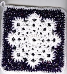 Linda's Snowflake Potholder~I also saw this as a granny square for an afghan... http://pinterest.com/pin/209769295113284346/
