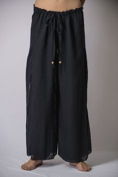 "Super soft organic cotton wide-leg Thai style palazzo pants. Sizing: One size fits most. Measurement: Waist: 24"" - 36"" Hip: Up to 40"" Inseam: 27"" Length: 37.5"""
