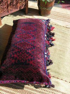 use rugs to cover cushions. Moroccan kilim cushion #floor #cushion #ideas