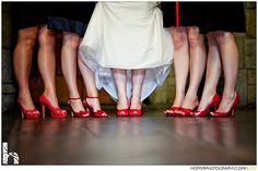 Love this idea!!! Black dresses, red sexy shoes & red bouquets ... :)