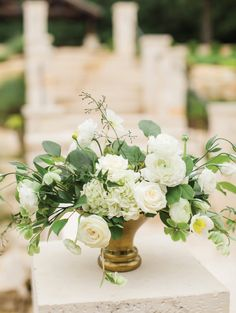 Gorgeous, white, neutral floral arrangement in a gold vase. Perfect for the grand entrance to your ceremony site! Taken at THE SPRINGS Event Venue in Aubrey, TX. Book your free tour today! White Floral Centerpieces, Gold Centerpieces, Wedding Entrance, Grand Entrance, Wedding Table Decorations, Table Wedding, Wedding Ceremony, Small Flower Arrangements, Bridal Flowers