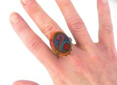 Abstract Orange Needle Felted Ring -- OOAK Concentric Circles and Swirls in Warm Tones with Antiqued Silver Plated Adjustable Band