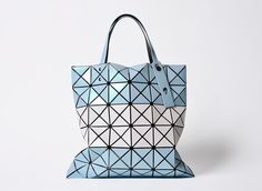 "Love the simplicity of Issey Miyake's 'BAO BAO ISSEY MIYAKE' line of bags/ pouches. The collection has the   theme of ""shapes made by chance"". This particular bag is a limited edition however the range is also available at his London stores."