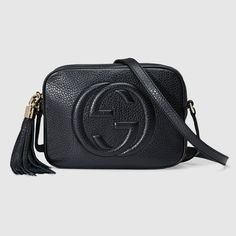 "Gucci - Soho Leather Disco Bag. A compact shoulder bag with a leather tassel zipper pull. Sized to fit the necessities. Made in our light, natural grain leather.  Black leather Leather tassel Embossed interlocking G Cotton linen lining Adjustable leather strap with 21.6"" drop Interior phone and open pockets Top zip closure Small 8""W x 6""H x 2.7""D Made in Italy"