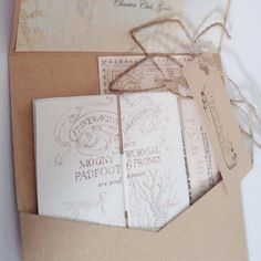 I love the look of these invitations. The Marauders Map invitation is beautiful, and the overall package fits the theme without looking cheesy.