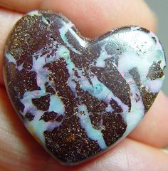 Boulder opal heart carving, 43 carats, red pinfire on both sides ...