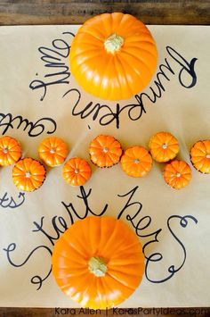 Pumpkin carving Halloween party with lots of ideas via Kara's Party Ideas! Use craft paper to cover your table!