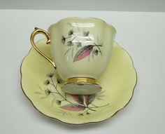 Vintage Royal ALbert Bone China gold handle and feet tea cup and plate