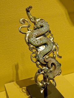 Nephrite and gilt bronze belt hook in the shape of a coiled dragon, Warring States Period to Early Western Han Dynasty, China 4th-3rd century BC.