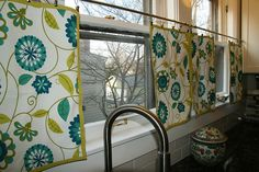 Flat cafe curtains - I would add horizontal seams in linen-like fabric.