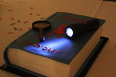 Oh do I want this Nancy Drew cake! Maybe I'll finally throw that ND party I've been wanting to do... though how many people do I know that are as nerdy about these books as I've been.