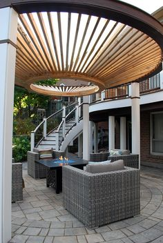 "Curves, curves, curves!  A funky design with a curved upper deck & staircase overlooking a circular pergola.  From ""Decked Out"" episode ""The Circular Pergola Deck"".  Design by Paul Lafrance Design."