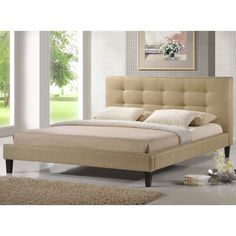 Raise your mattress up off the ground for a better nights sleep and add some sleek, modern style to your room with this contemporary king size platform bed frame. It is upholstered in a soft, neutral cream fabric with an attached, tufted headboard.