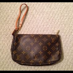 Authentic Louis Vuitton leather wristlet Authentic Brown leather wristlet with traditional Louis Vuitton logo print.  Brown interior, gold hardware, tan strap. Louis Vuitton Bags Clutches & Wristlets