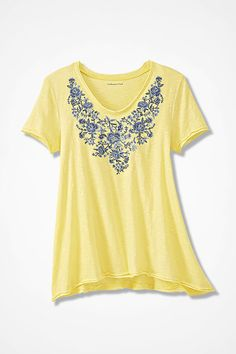 A sunny disposition is only the first of this top's charms it's graced with a cascade of embroidered florals around the V-neck. A-line silhouette is finished with double-layered raw edges; slight high/low hem.  #yellowTee #plussizetshirt #womenTee #EmbroideredTee #petiteWomenTee
