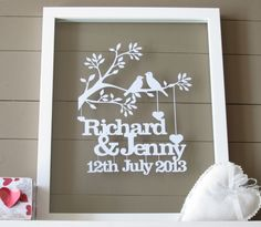 This is an original and unique papercut keepsake cut exclusively for you.  It makes a wonderful wedding or anniversary gift for the happy couple.  This piece is cut from a single piece of A4 cardstock in white but other colours can be chosen.    If purchased UNFRAMED it looks wonderful placed on your own backing coloured cardstock and framed in an A4 frame (Ikea Ribba frames are great).  If purchased FRAMED it will look gorgeous in the floating glass frame as pictured.   Please advise o…