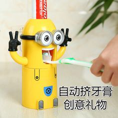 Vacuum extrusion automatic toothpaste dispenser yellow man Toothbrush holder with cup