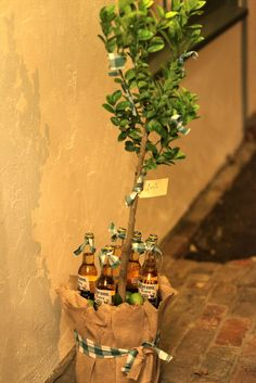 How fun is this gift? Love it.  A lime tree and case of Corona or a bottle of tequila.