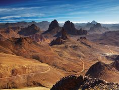Hoggar Mountains Top 10 Saharan Stops in Algeria 1. Beni Isguen This 14th-century town is one of Algeria's most fascinating. Traditional ways are strictly adhered to. Local women, who are draped in white shawls from head to toe, are allowed to have only one eye showing. Men and women lead completely segregated lives, and each gender has its own council. 2. Tamanrasset Called the 'red city' because of its red mud-brick houses this town is full of life and character. Situated in the heart of…