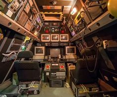 "Interesting idea: use old computer parts and other stuff to create a spaceship play room located in your attic or a closet in your child's bedroom. There are two car seats that make up ""mission control"" and a toy chest full of space suits and gear. The walls are covered in blinking lights, monitors, vents, and cables."