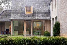 Facade of reclaimed whitewashed bricks one,  Reclaimed Belgian roof tiles