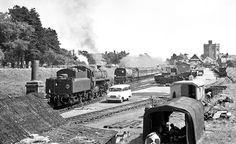 I was 20 when I captured this image. It takes me back to some very carefree years when life and society seemed much simpler and tranquil. Steam railways were my passion and girls were rather incidental!  It's the 17 August 1965 and New Milton's station and coal siding is teeming with activity. Today this is a pay-and-display car park and, thankfully, camouflaged by scrub.  The crew of BR 2-6-0 76033 are having a 'cuppa' in the shelter with a couple of railway workers, while WC Pacific 34099… Steam Trains Uk, Hampshire England, Steam Railway, Merchant Navy, Bullen, British Rail, Battle Of Britain, Steamers, Ways To Travel