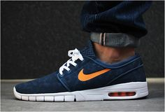 Blue and orange-ish. Yes I dig, but I don't really understand. Signature shoe of a pro skateboarder yet it doesn't look like it could stand up to the rigors of skating. I'm confused. Yes, I know he has a proper skate shoe. So what is this for? These things matter. ;p -  NIKE SB STEFAN JANOSKI MAX