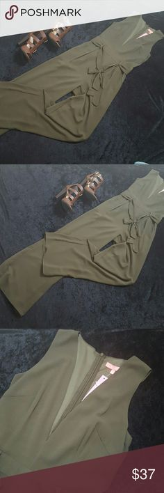 Olive green palazzo jumpsuit Beautiful olive green palazzo jumpsuit with a back zipper closure and accent belt. It has pockets!!! Pants Jumpsuits & Rompers