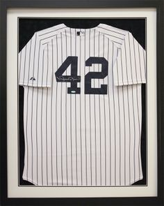 New York Yankees Pinstripes in a custom frame will look great in any man cave.  Custom frame design by Art and Frame Express in central NJ at our Edison location.