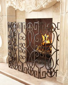"Bronze ""Fleur-de-Lis"" Fireplace Screen at Horchow. $295  Rustic bronze-finished fire screen mixes curves and angles with fleur-de-lis motifs to add dimension to the fireplace.•Made of wrought iron.  •55""W x 13""D x 31""T standing.  •Imported."