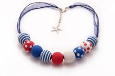 Hey, I found this really awesome Etsy listing at https://www.etsy.com/listing/264508871/red-and-blue-round-beaded-polymer-clay