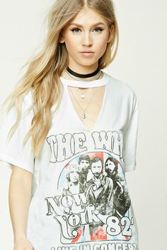 """A soft cotton knit tee featuring a front """"The Who New York 82' Live in Concert"""" graphic with an image of the band, a crew neckline, a geo-shape raw cutout, dropped shoulders, short sleeves, and a boxy silhouette."""