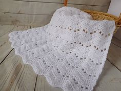 White crochet baby blanket. Gender neutral baby afghan. This is a very special handmade crochet baby blanket. This baby afghan will make a wonderful baby shower gift. This is a chevron type pattern but with more of a ripple effect. This blanket would make a lovely addition to your baby nursery decor. Perfect also, for travel, strollers, prams, cribs, tummy time and photo props