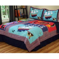 Pirate Treasure is a fun large scale patchwork quilt with large ico...