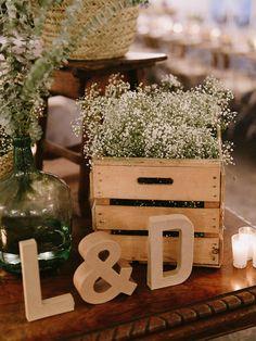 Rustic Wooden Crates filled with Gypsophila & L & D Letters | Laura de Sagazan boho wedding dress | Destination wedding in Spain | Outdoor ceremony | al fresco dining | Image by Marcos Sánchez | http://www.rockmywedding.co.uk/laura-david/