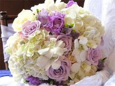 Lavender and Ivory Bouquet - if decided to stick with the original colors - could bring in the gold by wrapping the steps in an antiquey gold fabric.
