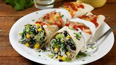VEGETABLE ENCHILADAS - This vegetable enchilada recipe is the perfect Mexican, vegetarian treat. Corn tortillas are stuffed with rice, black beans, cheese and sour cream, before being drizzled with a tomato sauce of cumin and Knorr Vegetable Stock Pot. Vegetable Enchiladas, Enchilada Recipes, Corn Tortillas, Vegetable Stock, Cooking Classes, Tomato Sauce, Black Beans, Fresh Rolls, Sour Cream