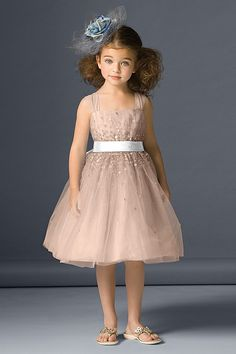 Watters Seahorse dress 46231    Tulle tea length dress with daisy sequins sprinkled on bodice and skirt and single faced satin ribbon at waist.  SIZES: 2T-14  COLORS: NECTAR / SNOW  FABRICS: TULLE / SINGLE FACED SATIN RIBBON
