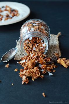 The Best Homemade Almond Joy Granola made in just 30 minutes! This stuff is like candy its so addicting. From the dark chocolate chunks, to the coconut flakes, and  the cinnamon toasted granola. You need this recipe!   joyfulhealthyeats.com #recipes