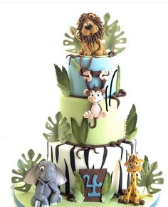 A wild party for a wild Four year old. created this cake using our Curly Number and leaves. The animals are hand molded and the color combination superb! Cake 1 Year Boy, 1 Year Old Birthday Cake, Jungle Birthday Cakes, Baby Boy Birthday Cake, Animal Birthday Cakes, Boys 1st Birthday Party Ideas, Wild One Birthday Party, Jungle Cake, Jungle Party Decorations