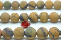 47 pcs of Natural Yellow Banded Picture Jasper matte round beads in 8mm (06823#)