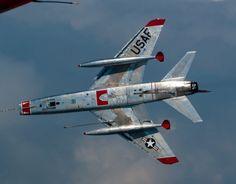 A North American F-100 Super Saber banks away.
